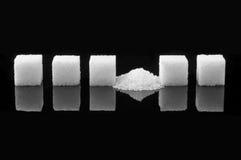 被碰撞的糖立方体 库存图片
