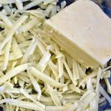 被磨碎的切达乳酪 库存图片