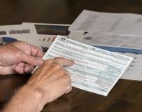 1040被简化的形式允许归档在明信片的税 免版税库存图片