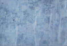 被粉刷的肮脏的蓝色混凝土墙 库存照片