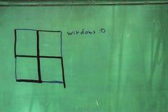 被绘的和修改过的十字记号作为在绿色背景的一个窗口 免版税库存图片