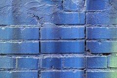 被绘的蓝色葡萄酒难看的东西砖墙纹理特写镜头,都市b 免版税库存图片