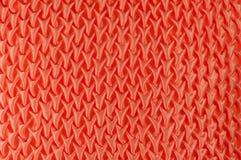 被绣的橙色模式枕头 免版税图库摄影