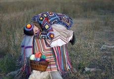 被编织的礼服的休眠的女孩 免版税图库摄影
