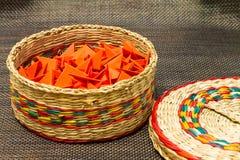 被编织的秸杆篮子与红色纸的 免版税库存照片