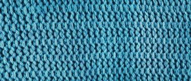被编织的蓝色羊毛,全景 免版税库存照片