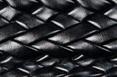 被编织的黑色皮革模式 免版税库存图片