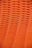 被编织的,橙色背景 库存照片