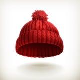 被编织的红色盖帽 免版税库存照片