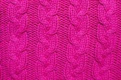 被编织的羊毛背景,红色纹理 免版税库存图片