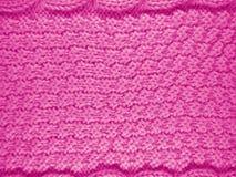 被编织的羊毛背景-桃红色 库存照片