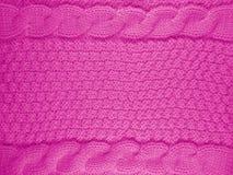 被编织的羊毛背景-桃红色 免版税库存图片