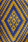 被编织的织品手。 免版税图库摄影