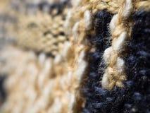 被编织的织品羊毛纹理关闭作为背景 库存照片
