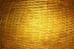 被编织的黑暗的金黄竹子 图库摄影