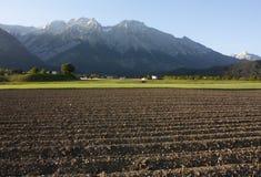 被耕的阿尔卑斯地产 免版税库存图片