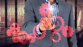 被聚焦的商人指向的综合图象 免版税库存照片