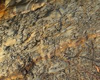 被腐蚀的岩石背景  免版税库存图片