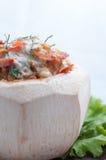 被蒸的咖喱鱼、虾和乌贼在椰子 免版税库存图片