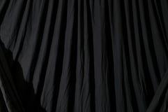 被装饰的黑背景布料 库存照片