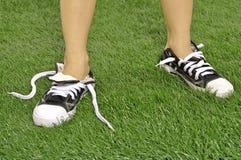 被解开的鞋子 免版税库存照片