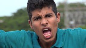 被触犯的或恼怒的青少年的男孩 免版税图库摄影