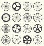 被设置的传染媒介:自行车轮子剪影 免版税库存图片
