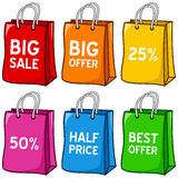 被设置的动画片五颜六色的购物袋 免版税库存照片