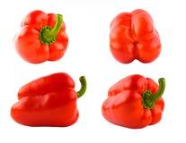 被设置的四个红色甜椒 库存图片