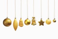 被设置的圣诞节金黄装饰品 免版税库存图片
