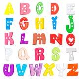被设置的字母表婴孩塑料信件 库存图片