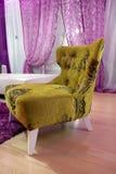 被设计的公寓扶手椅子 免版税库存照片
