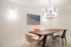 被设计的垂饰和椅子 免版税库存图片