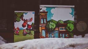 被转换成与逗人喜爱的绘画的艺术壁画美化Coeur d ` Alene爱达荷城市的电子箱子 免版税库存照片