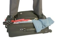 被过度充填的手提箱 库存照片