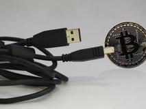 被连接的Bitcoin USB 库存图片