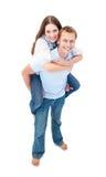 被迷恋的夫妇背上享受乘驾 免版税图库摄影