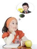 被迷恋的女孩学习 免版税图库摄影