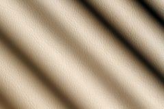 被遮蔽的米黄皮革 免版税库存照片