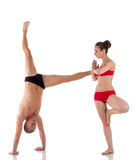 被配对的瑜伽 人身体H形成的信件 库存图片