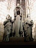 被采取的教会宗教雕象三名妇女 库存图片