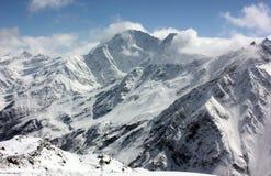 被采取的黎明轻的山峰照片紫色多雪 图库摄影