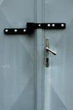 被锁的灰色金属门双 免版税库存照片