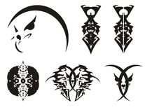 被锐化的抽象老鹰头、猫的头和剑-部族标志 免版税库存照片