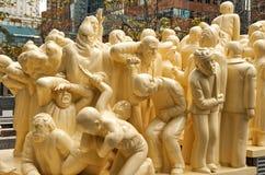 被阐明的人群雕塑 库存照片