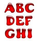 被隔绝的套红色胶凝体和焦糖字母表大写字母  免版税库存图片