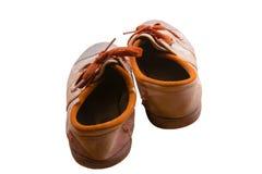 被隔绝的棕色学生鞋子 免版税库存照片