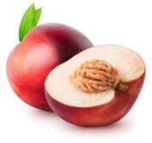 被隔绝的油桃 整个油桃果子和一半与在白色背景隔绝的叶子与裁减路线 免版税图库摄影