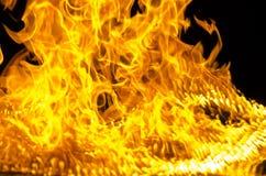被隔绝的灼烧的火焰或火在黑背景 库存照片