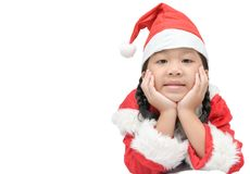被隔绝的红色圣诞老人帽子的逗人喜爱的矮小的亚裔女孩 图库摄影